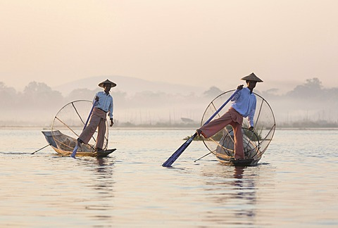 Intha leg rowing fishermen at dawn on Inle Lake, Shan State, Myanmar (Burma), Asia